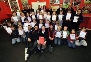 Renishaw gives financial donation to Gloucester Rugby's education scheme